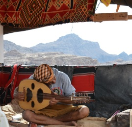 A local man playing oud (an Arab lute) in one of the highest places in Petra