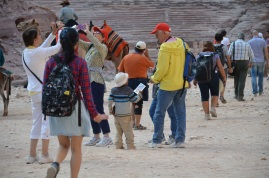A little child is trying to sell a postcards to a tourist, in Petra, Jordan
