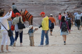 A little child is trying to sell a postcards to a tourist, in Petra, Jordan (2)